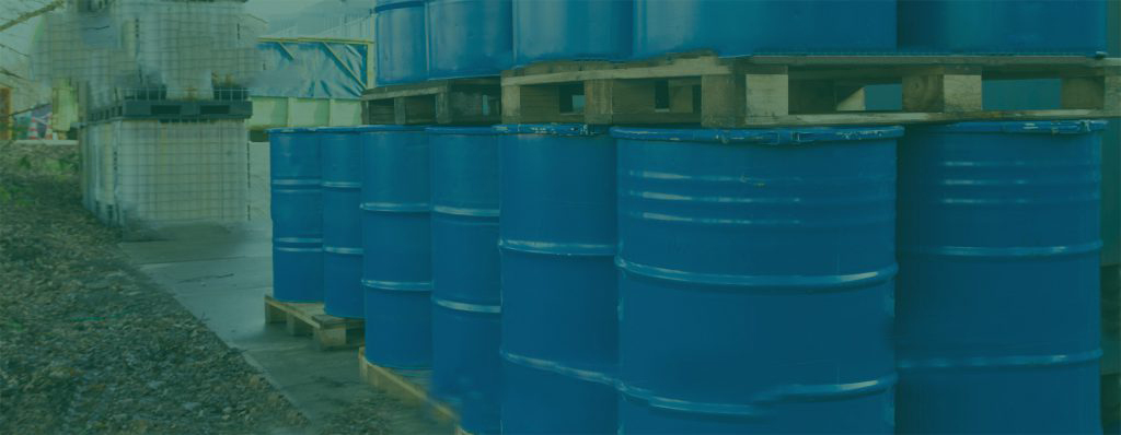 banner image of a line of blue hazardous waste barrels with a green overlay